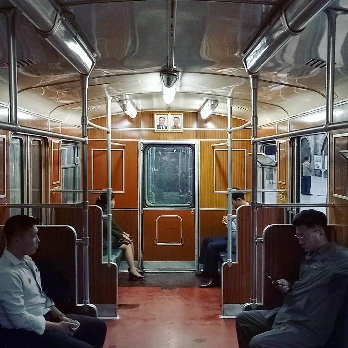 President's portrait - inside the Pyongyang subway car