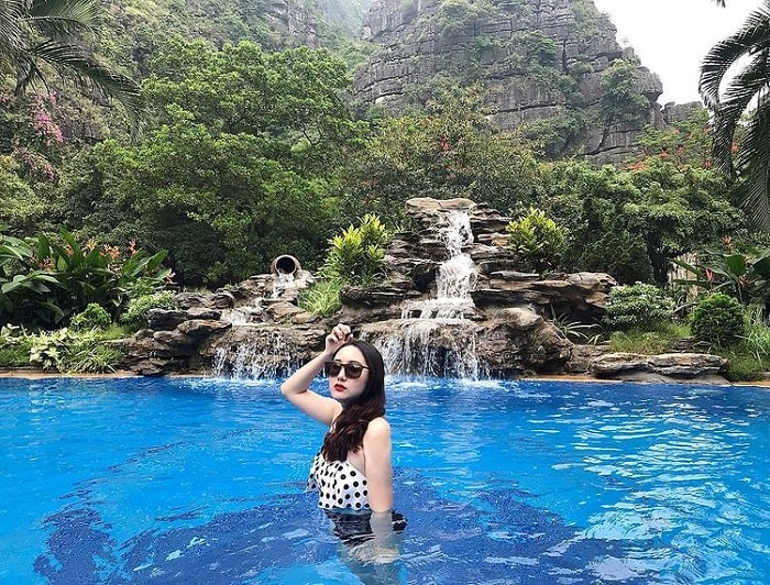 Bathing in the outdoor swimming pool at Hang Dance Ecolodge Ninh Binh