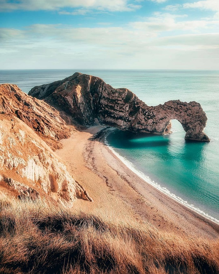 Durdle Door is a natural limestone arch in the sea, caused by millions of years of erosion - Jurassic Coast