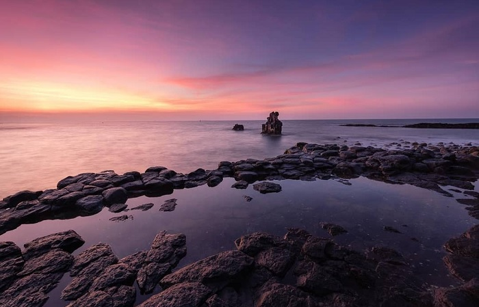 rock in the middle of the sea - an attraction at the rocky cliffs of Thach Ky Dieu Dau
