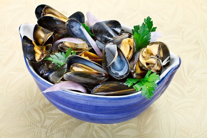 Traditional Mouclade - Mussels with curry cream sauce.  - Features of French cuisine