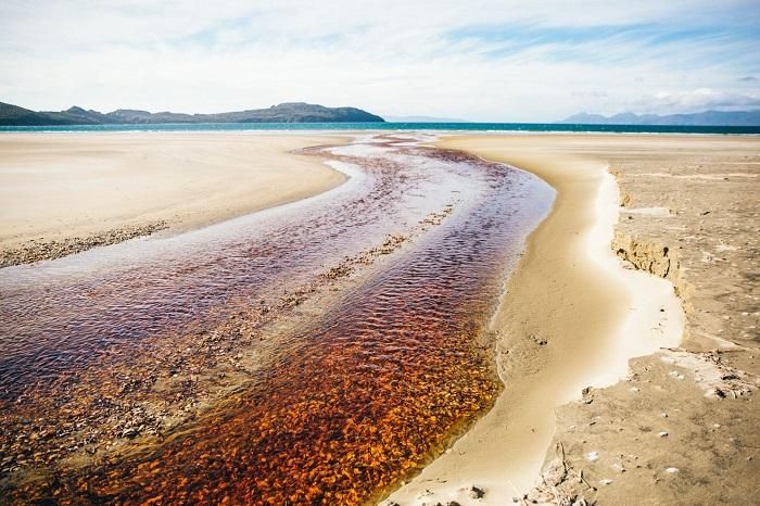 Beautiful setting on a deserted beach on Stewart Island
