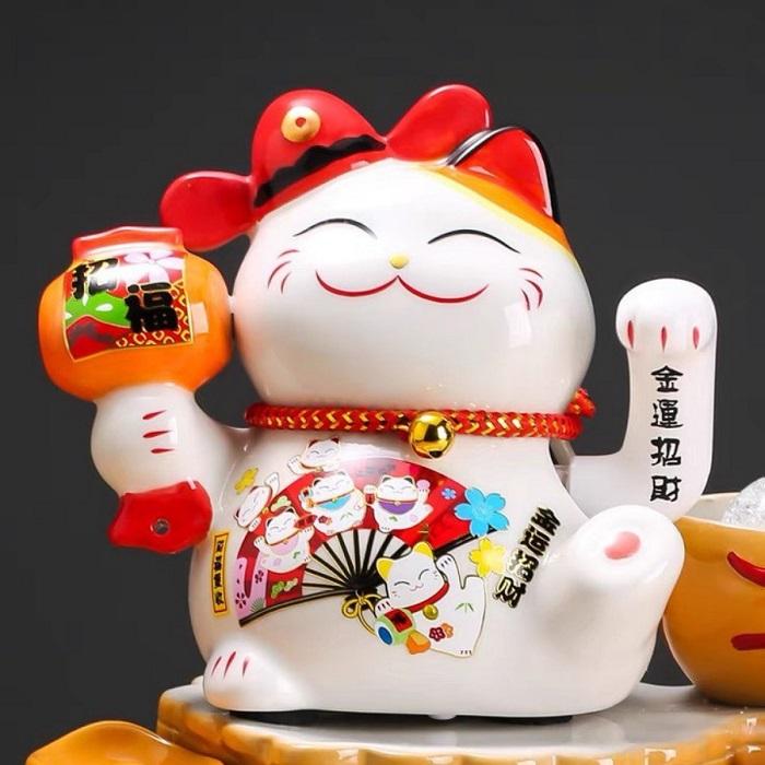 Tìm hiểu về những vật được đặt trên tay mèo thần tài Maneki Neko