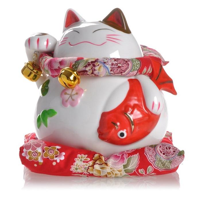 Tìm hiểu về những vật được đặt trên tay mèo thần tài Maneki Neko ở Nhật Bản