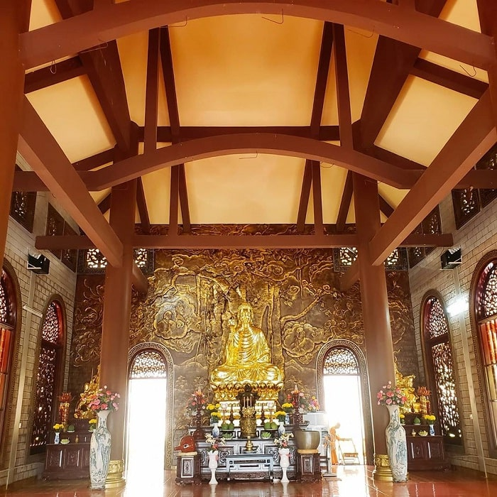 Golden Buddha statue - the sacred symbol of the Chan Nguyen bamboo temple