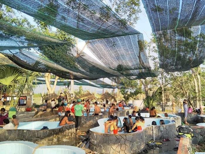 Bathing in hot mineral springs in Nhan Tam eco-zone