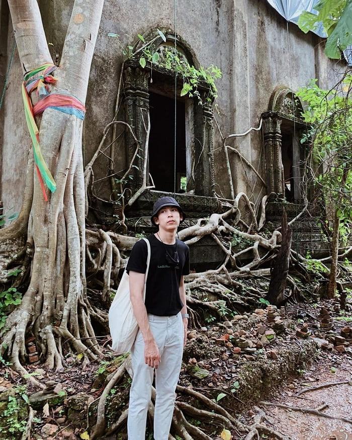 Treeside pagoda - ancient construction in Sangkhlaburi village