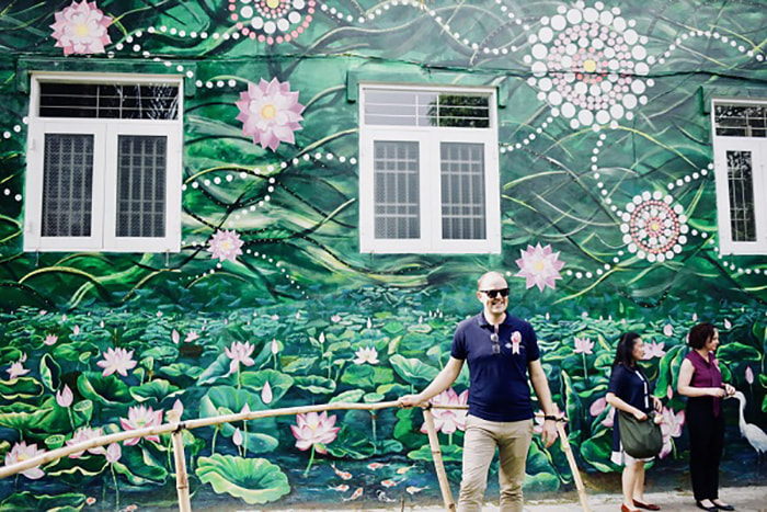 Check in Cao Lanh frescoed village - Lotus painting in fresco village