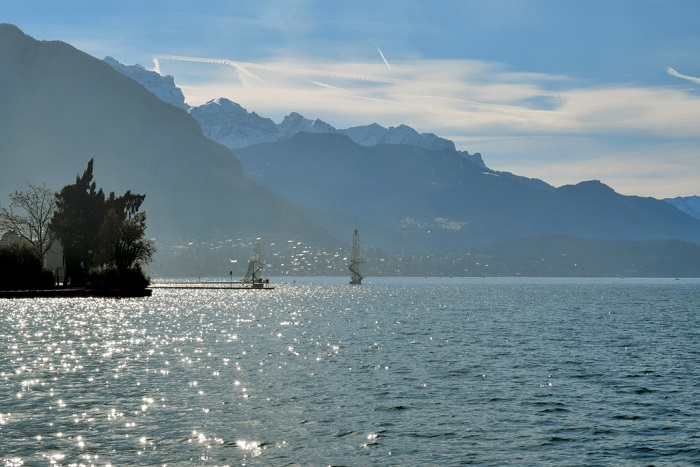 Lake Annecy and snow-capped mountains - Annecy Venetian Carnival